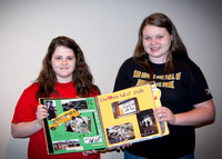 Two Henryville High School students with their custom scrapbook (inside) that was given to Lady Antebellum.
