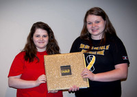 Two Henryville High School students with their custom scrapbook (outside) that was given to Lady Antebellum.
